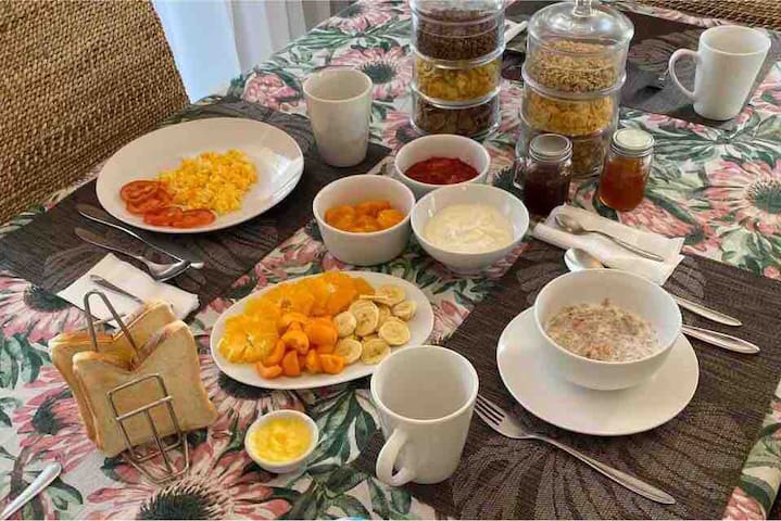 Breakfast included: variety of cereals, yoghurt, fresh fruit, fruit compote, toast, butter, jam, eggs, tea, coffee and juice.