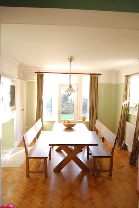 Dining Room with long table can seat 10 - easily 12 in a cosy way
