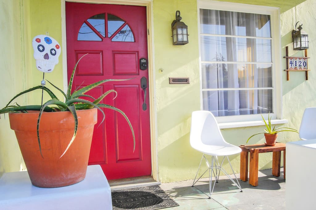 A happy home-away-from-home. Front porch for sitting, red door for fun.
