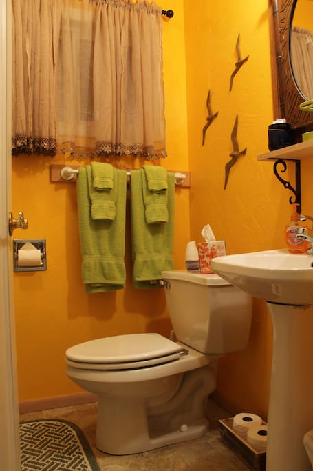 The bathroom is a shower & tub combo with a small sink and toilet.
