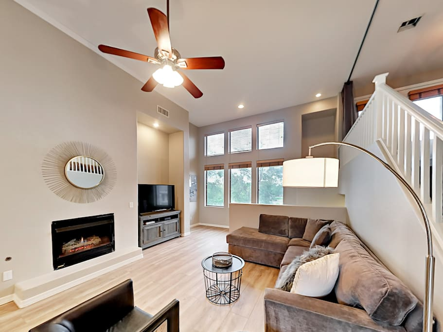 High ceilings, hardwood floors, and marble detailing lend an airy, modern feel to this condo.