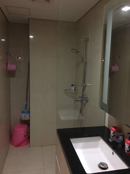 Shower bathroom with electric water heater.