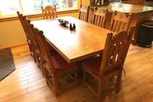 8 seat dining table with extra chairs available in downstairs bedroom