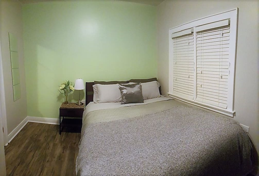 "APPLE ROOM: 1 queen firm orthopedic beds, fits up to 2 people comfortably. Private en-suite 3 piece bathroom. 43"" Smart 4K TV with Netflix ready to go! Room is a private locked room."