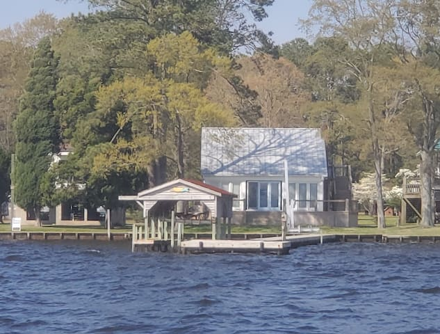 Modern Farmhouse Cottage on water with dock
