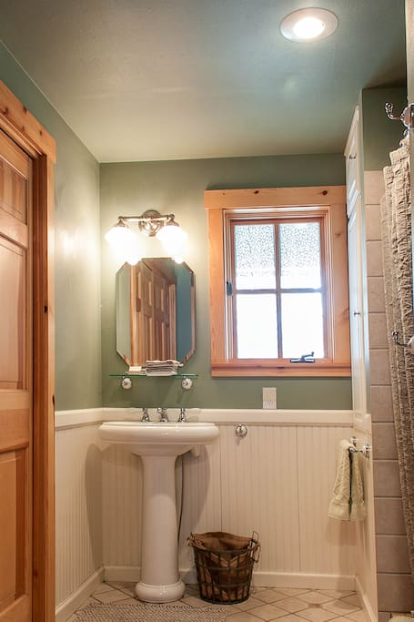 The downstairs bathroom, private for your group. Walk-in shower and washer/dryer.