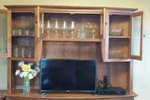 """Full selection of glassware for your enjoyment:  wine glasses, tumblers, juice glasses.  Also serving pieces that match the dishes.  High definition TV is enabled with """"Sling TV"""" cable, as well as ChromeCast and a DVD player."""