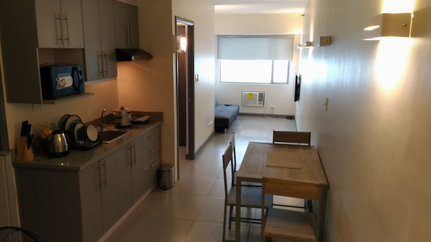 WORK WITH US HOME, BURGUNDY MCKINLEY PLACE PASAY
