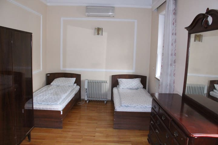 TWIN BEDS WITH AIR CONDITIONS