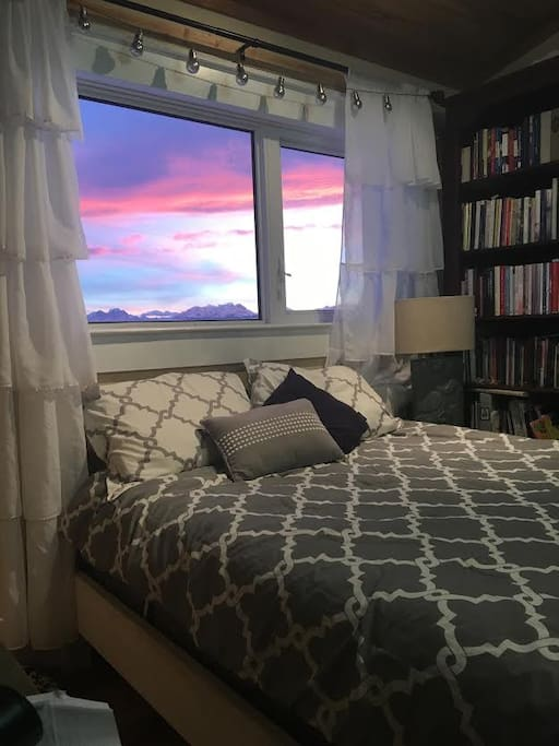 Beautiful sunsets and mountain views outside this lovely bedroom