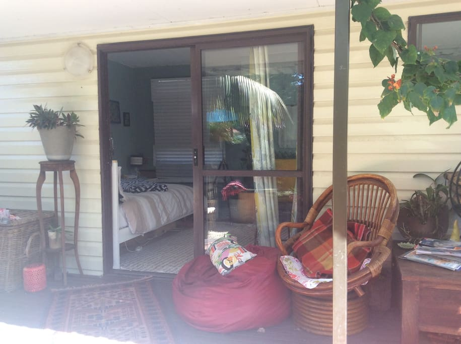 Deck and seating on small deck off cabin, steps down to courtyard and bbq area