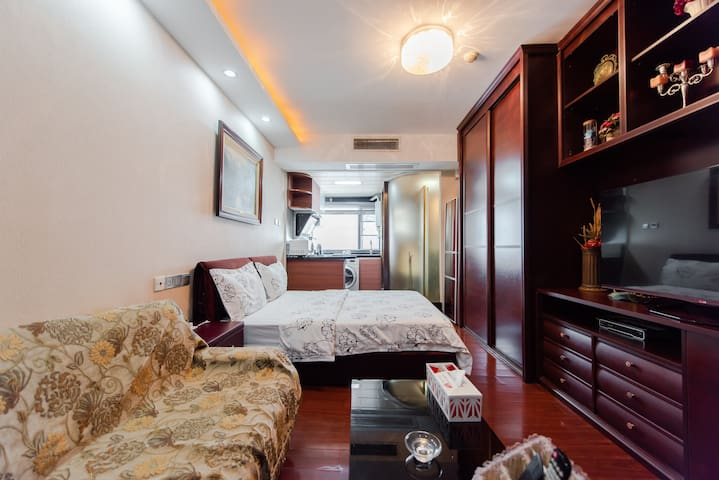 Huangqianhbei Apartment温馨公寓