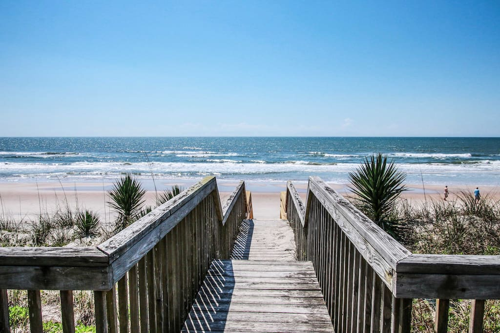 Enjoy having access to a private beach steps away from your vacation rental.