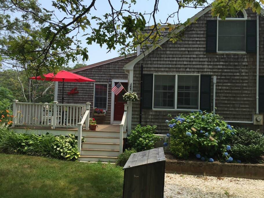 Spacious yard, deck, Gas grill, lawn chairs, patio table and chairs for dining outside.