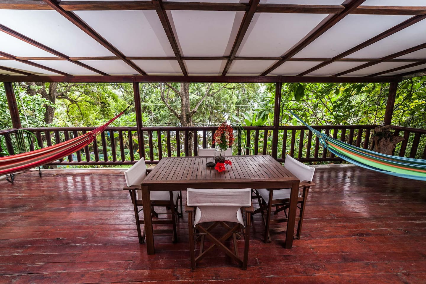 Porch with dinning table and awesome hammocks