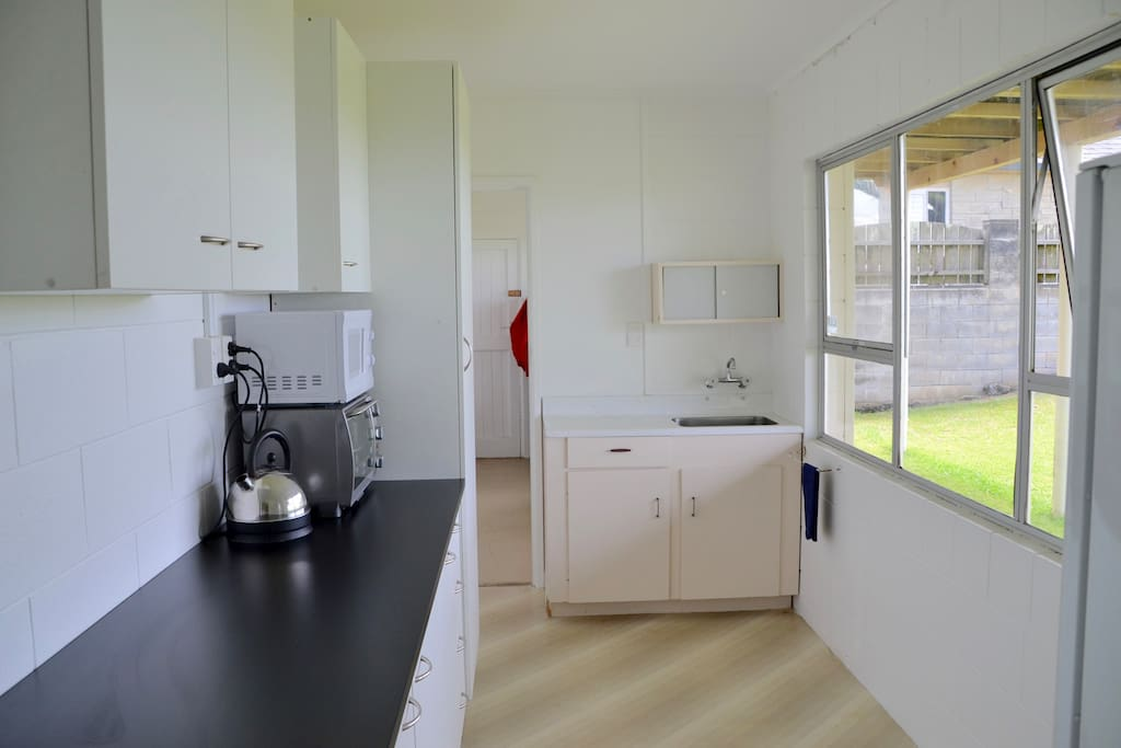 Kitchen showing microwave and convection oven on bench