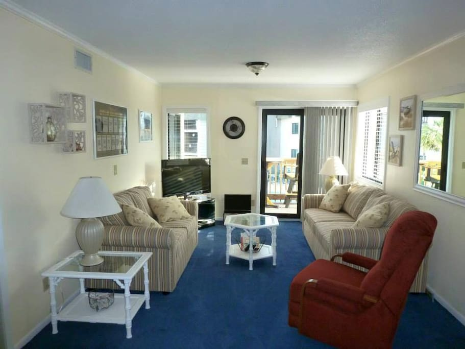 Entire Condo is Newly Renovated! Large Living Room with Lots of Seating and Pull-Out Sofa Bed.