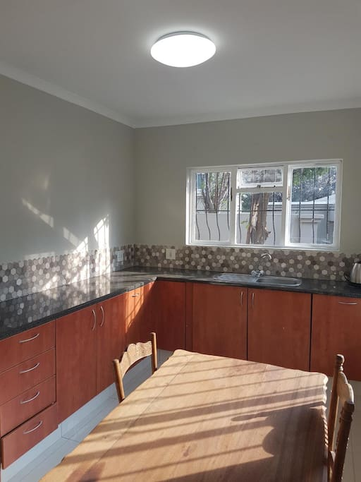 Newly renovated large Kitchen with loads of sun and lots of cupboard space.