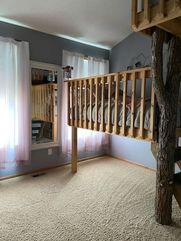 """2nd bedroom with two """"treehouse"""" bunk beds (one full, one twin).  A super fun room for your kiddos!"""