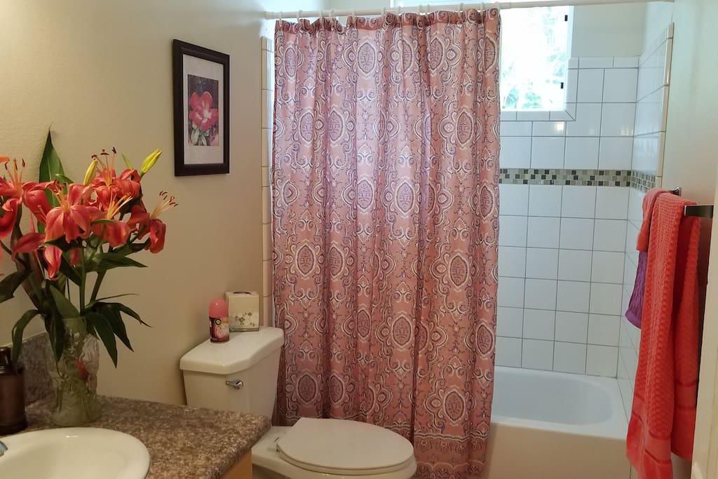 Full Bath with tiled tub and shower.  Shampoo, conditioner, body wash,