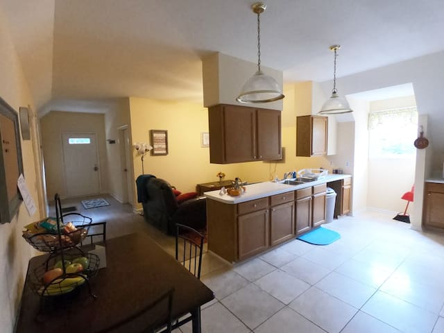 View of the apartment's kitchen, dining and living room.