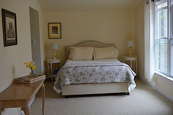 Queen Bed & en suite Bath with View of the Pool and Garden. Pocket doors to sitting room, fire place and Juliet Balcony