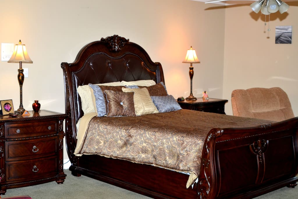 Large En-Suite with queen bed, desk, 42-in TV, reading nook, and refrigerator