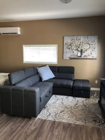 Sectional couch which pops up to be a double bed.
