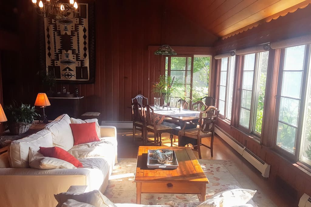 The great room/dining room has a full wall of windows to enjoy the magnificent views. This is part of your private space during your stay. We can put a fire in the hearth for you when the weather is cold outside.