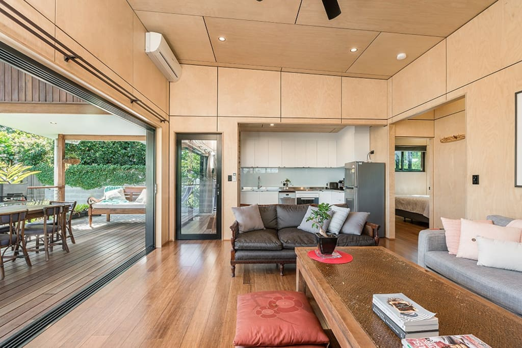 Classic and timelessly furnished open plan living area and kitchen opening out to huge deck -perfect for alfresco dining.