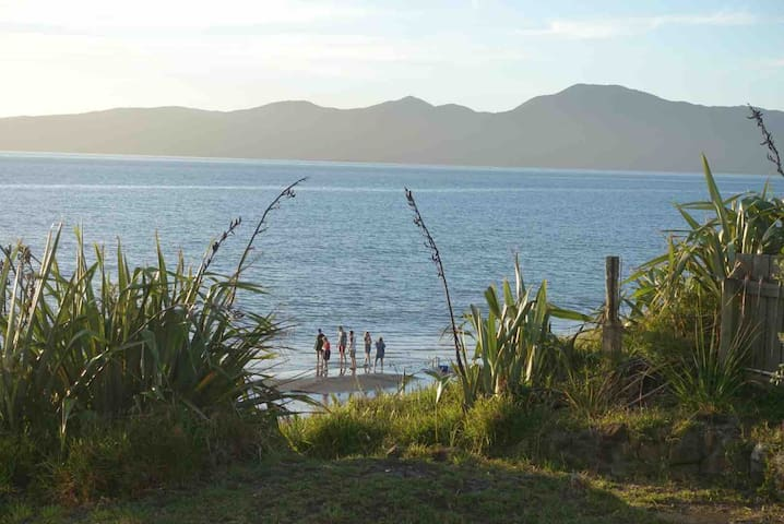 Private beach track runs from the property onto beautiful beach, safe for swimming and great for walking. Kapiti Island in the background.