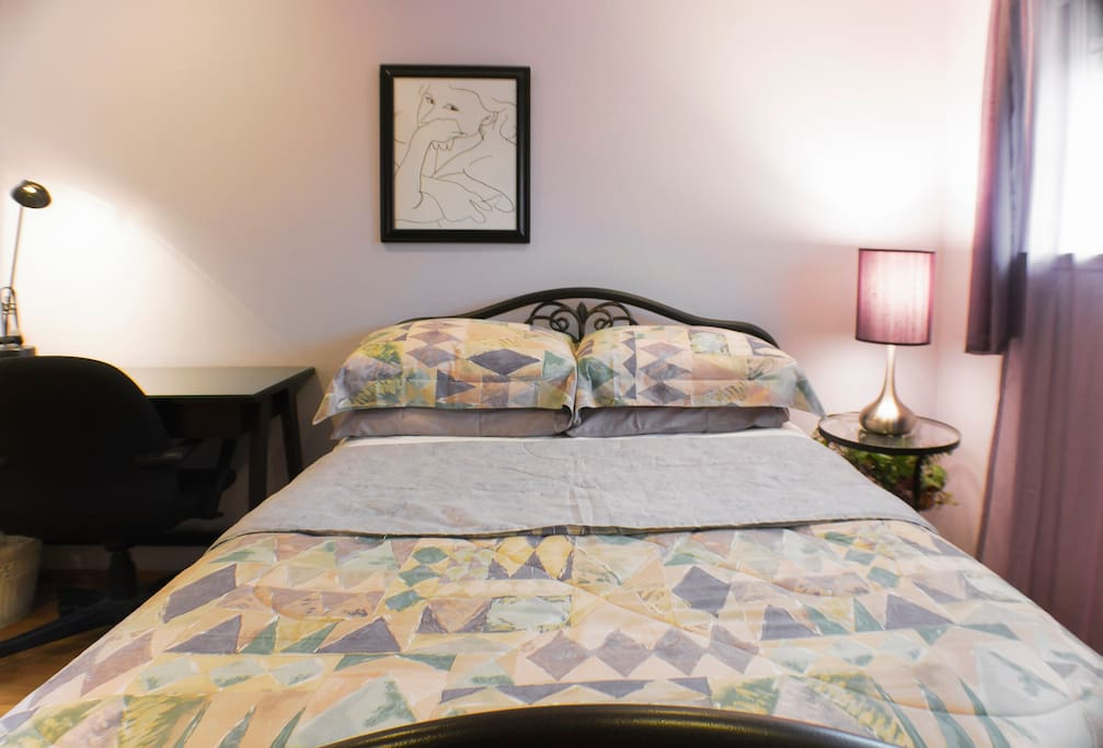 Quilted pad-topped double bed.