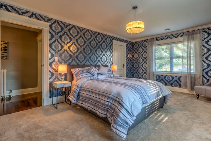 There are 4 bedrooms on the second floor, 3 of them have Queen sized beds, and 1 of them has two single beds.