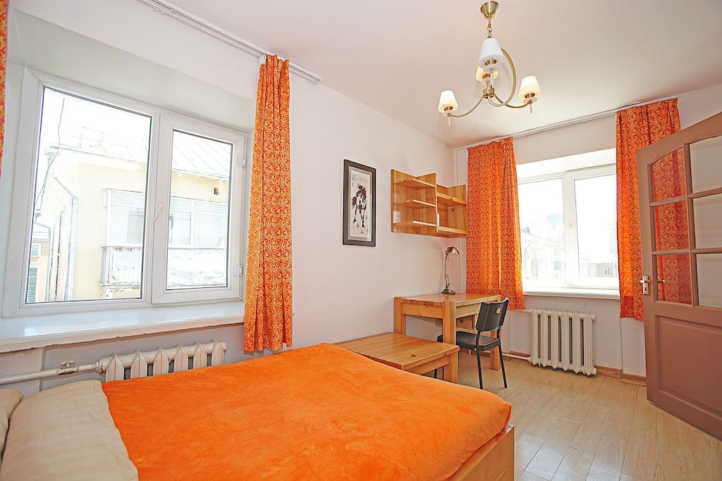 The bedroom is clear, bright, with a lovely wooden desk as well as storage and a kind bed for your comfort.