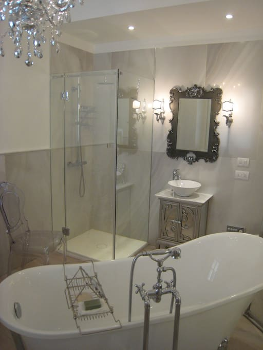 The bathroom to Suite Regina is a private domain -  'Mother of Pearl Alabaster' tiles, claw-foot bath, mirror-glassed shower, washlette toilet, and fluffy white towels