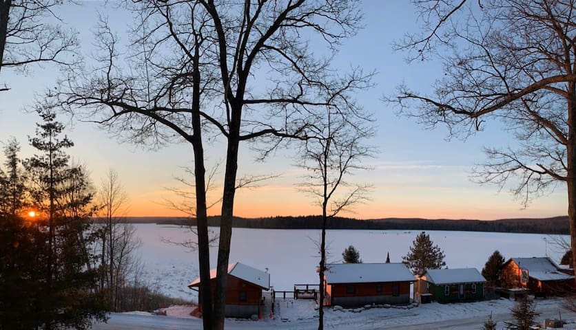 Cold winter morning of the cabins and lake from our hillside cabin.