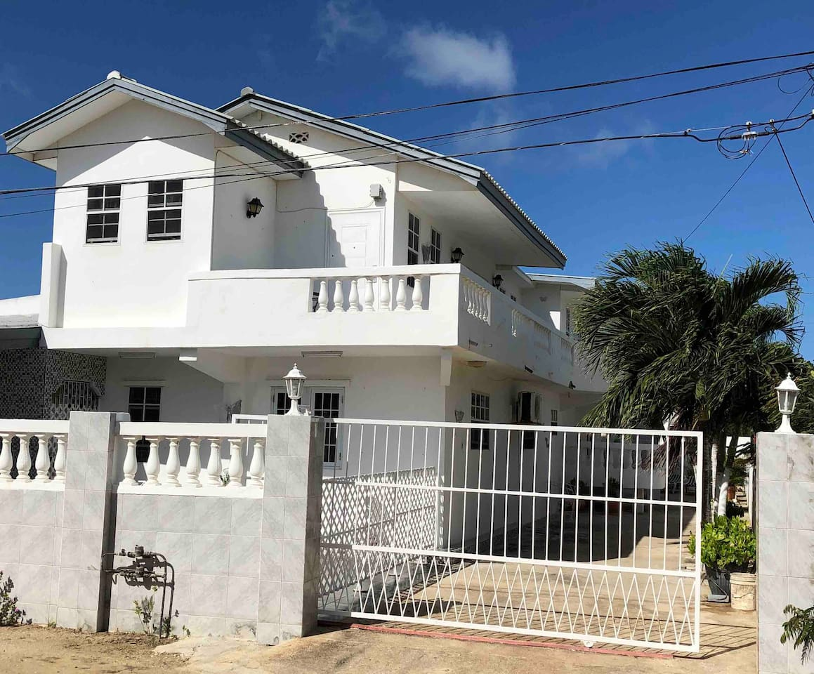 Rowy's parents house with on the 1st floor Rowy's fully equipped apartment with 2 bedrooms with air conditioning 2 douche/toilets 1 living room 1 dinning room 1 kitchen. Below on ground floor parking place for 2 vehicles