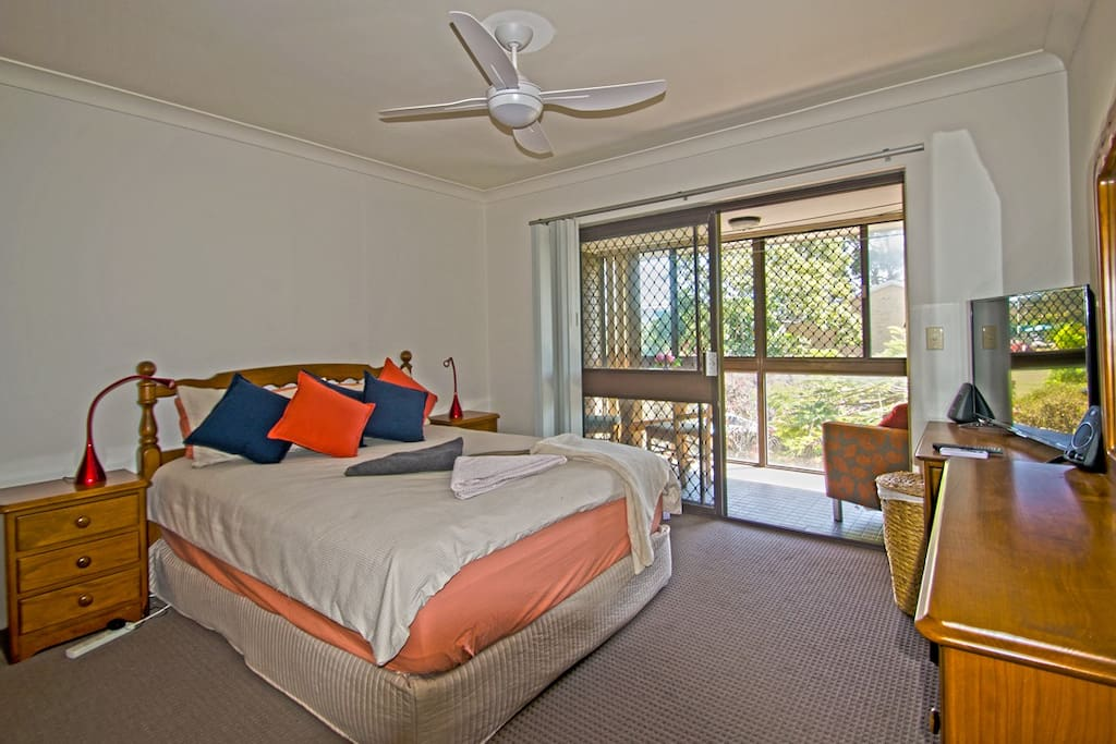 Master bedroom relax in super comfortable Queens size bed with HD TV and your private balcony