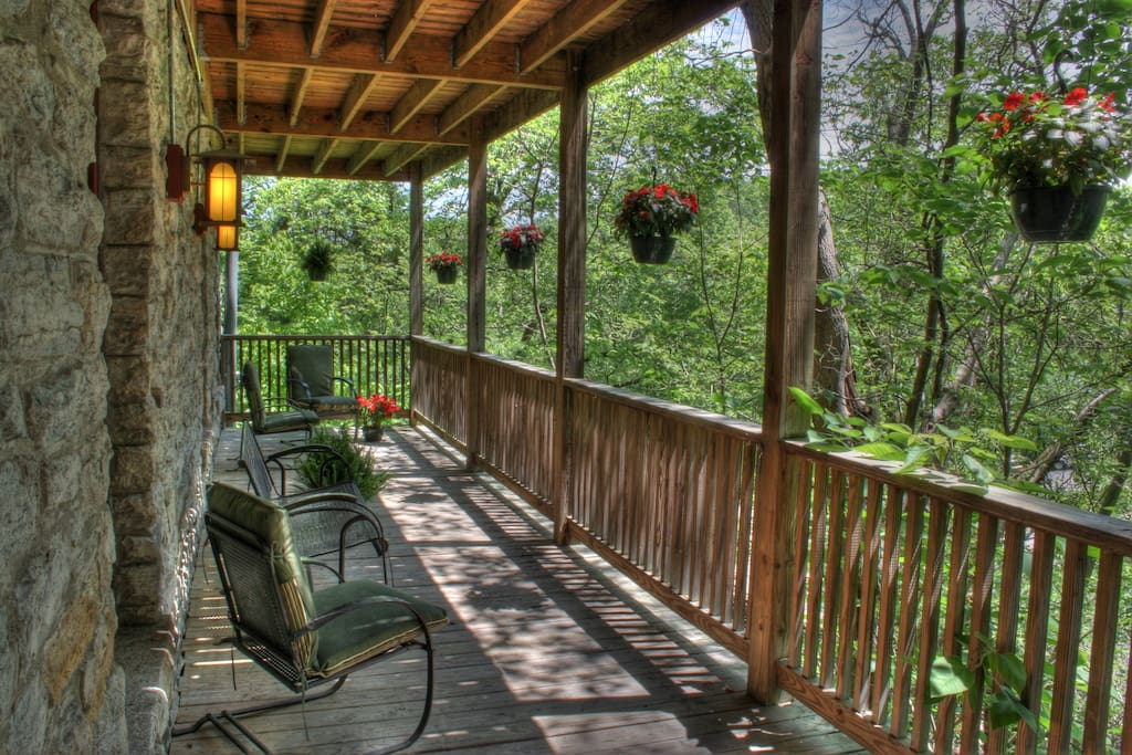 Large terrace overlooks a wooded area...