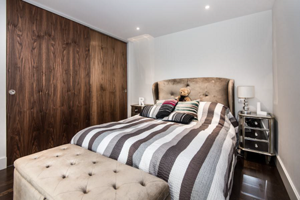 Master bedroom with access to private balcony overlooking the River Thames