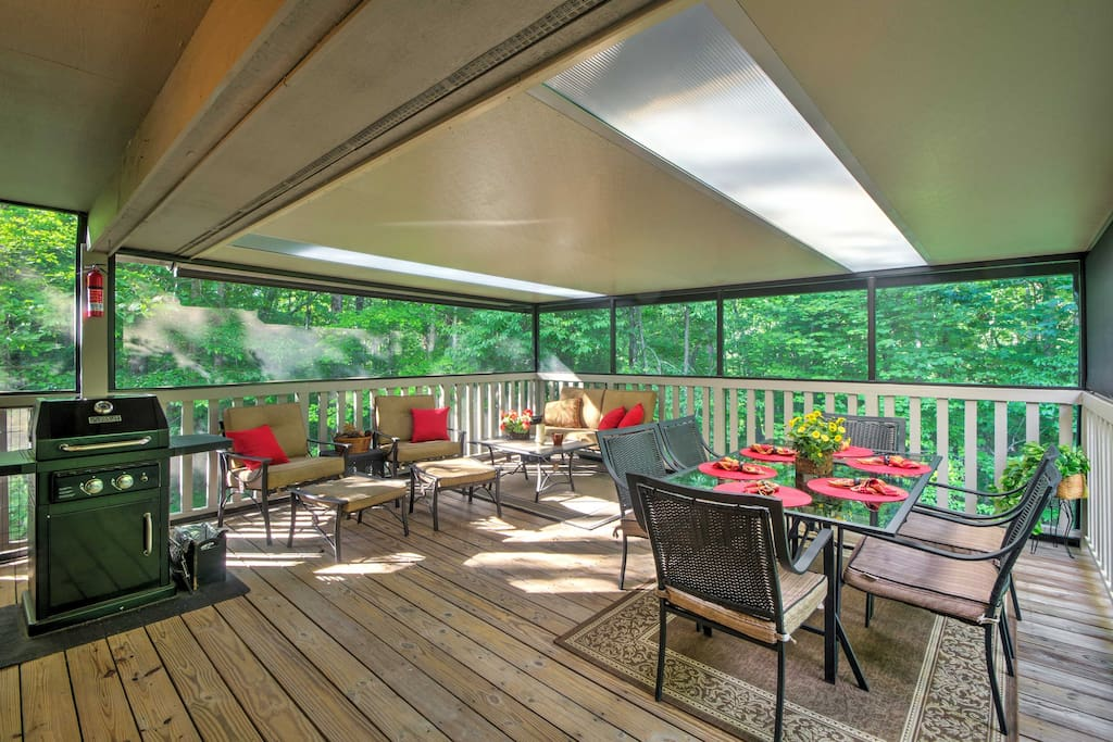 Lounge in the outdoor living space, complete with a screened  in porch.