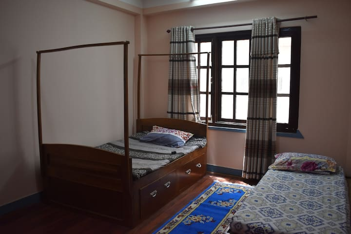 Bedroom B: One large single bed and a small single bed