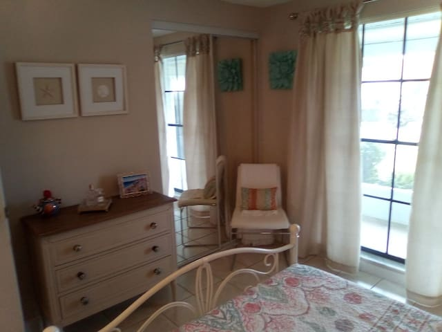 Warm, safe, secure bedroom in sunny Tampa.