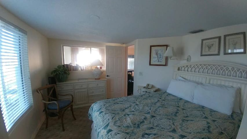Queen size bed in the light and bright bedroom!
