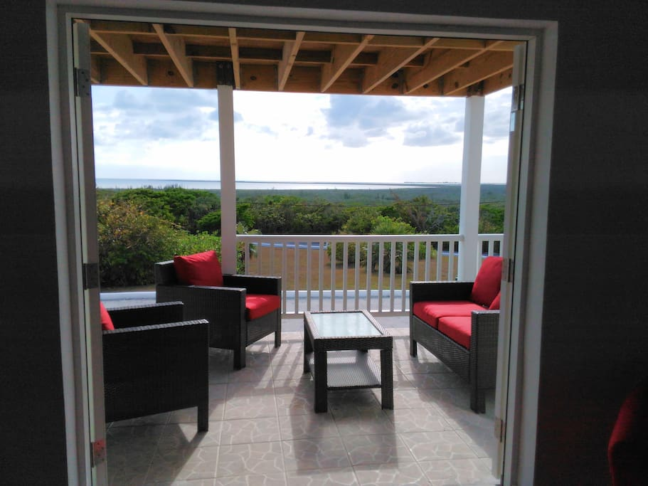 Spectacular panoramic views of the Caribbean & Atlantic oceans and majestic rolling hills of the island.  The house has spacious patios and balconies with outdoor seating to enjoy the breath taking scenery.