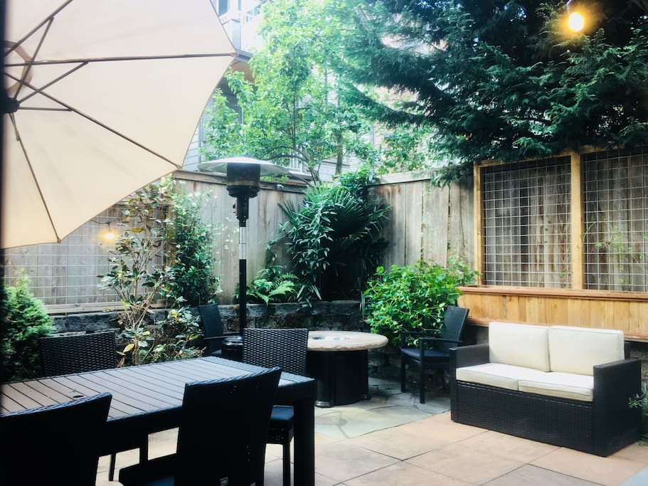 Private backyard garden with firepit, space heater, and bbq grill.   Should see it at night all lit up!