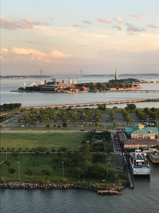 View of Statue of Liberty, Ellis Island, and Verrazano Narrows Bridge from living room