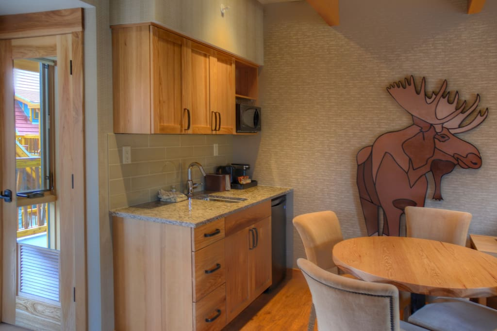 Prepare a meal in the equipped kitchen nook with mini-fridge, microwave and sink.