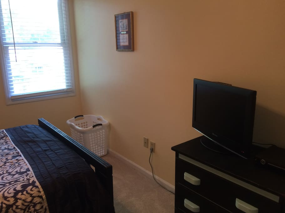 A tv and dvd player available for a relaxing night in bed. The dresser is open for storage space.