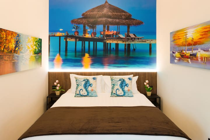 Sea, sand, and the sunset - let all your worries be washed away when you stay in our idyllic third bedroom with a Caribbean feel!
